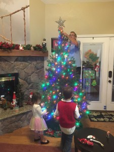 NCCF Founder, Gary Nice decorating the Christmas Tree with his family.
