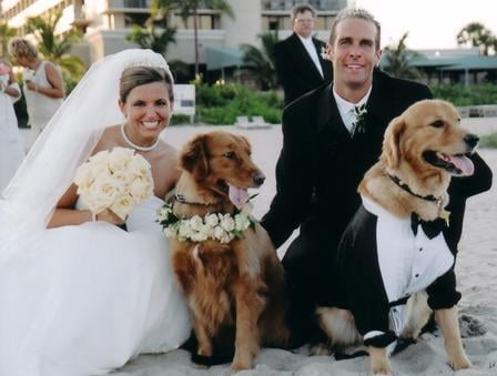 Chris and Eileen Pike with Golden Retrievers Skyler and Kiara